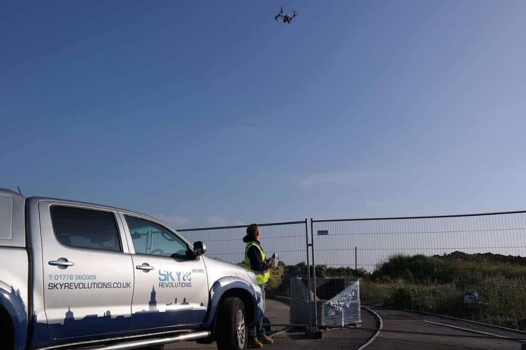 Sky revolutions truck and drone in operation