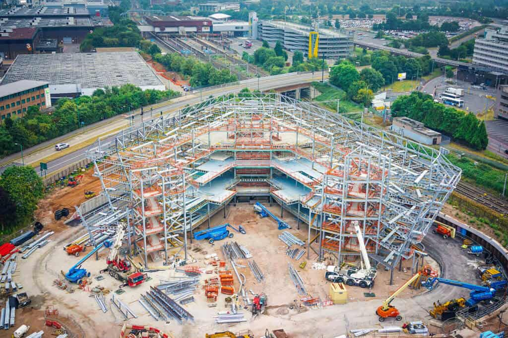 Construction progress photography delivered using mast, drone and camera technology