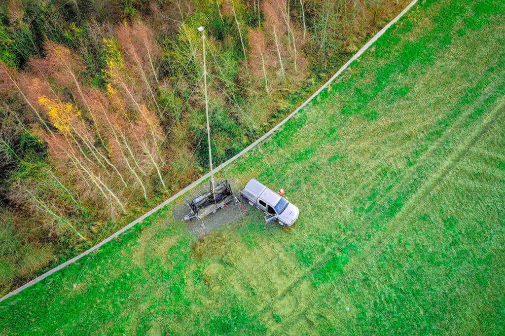Aerial image of a time lapse masts being set up in a field