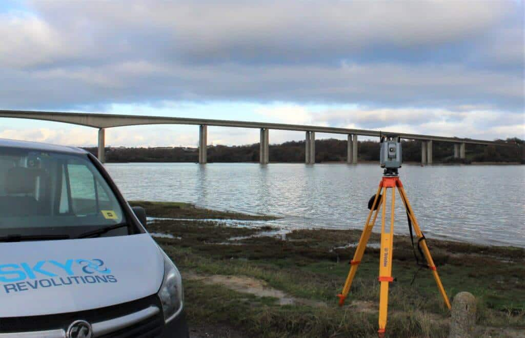 Sky revolutions van and instrument set up for topographic survey